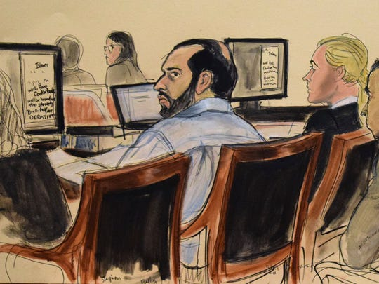 This courtroom sketch provided by artist Elizabeth Williams shows defendant Ahmad Khan Rahimi in court during opening arguments on the first day of his federal trial Monday, Oct. 2, 2017, in New York.