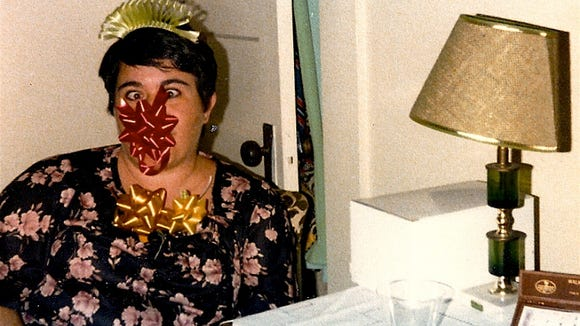 The author's mom once found a box of bows and proceeded to stick them on her head as a joke. But there was one particular day she wasn't in a joking mood.