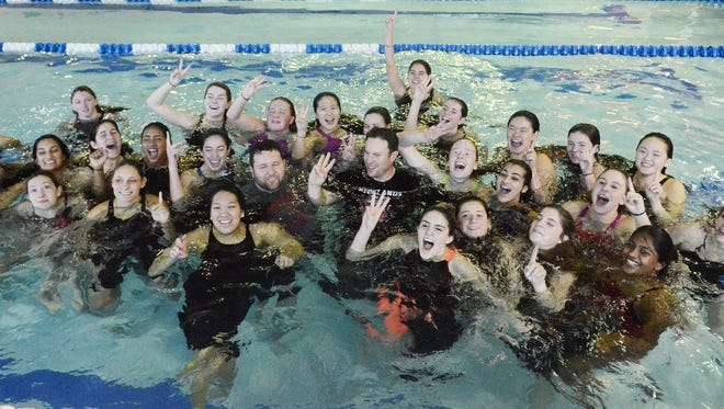 Northern Highlands celebrates in the pool after winning the North 1, Group B final.