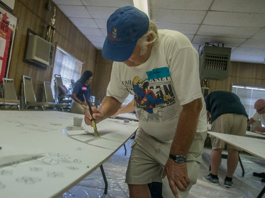 Ron Fiulmer paints on the mural that will go to South Lawn. Volunteers gathered at the E.D. Nixon Community Center on Saturday, June 23, 2018, to paint by numbers on nine murals for Montgomery schools.