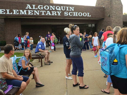 Students wait for the school doors to open at Algonquin Elementary School.