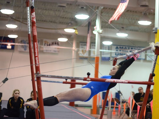 Hallie Roman performs on the uneven bars Monday, Feb.