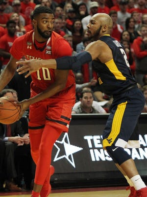 Texas Tech Red Raiders guard Niem Stevenson (10) looks for an opening against West Virginia Mountaineers Jevon Carter (2) in the first half at United Supermarkets Arena.