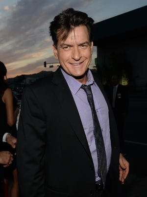 """Actor Charlie Sheen arrives for the premiere of Dimension Films' """"Scary Movie 5"""" at ArcLight Cinemas Cinerama Dome on April 11, 2013 in Hollywood, California."""