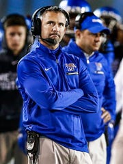 Dejected University of Memphis head coach Mike Norvell looks on as the Tigers fall to the University of South Florida 49-42 at the Liberty Bowl Memorial Stadium.