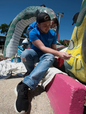 University of West Florida students, Isaac Witt helps to spruce up the Goofy Golf course at the First Tee facility on Navy Blvd Tuesday, April. 17, 2018. The Alpha Tau Omega fraternity brothers are volunteering their time during UWF's Day of Service activities.