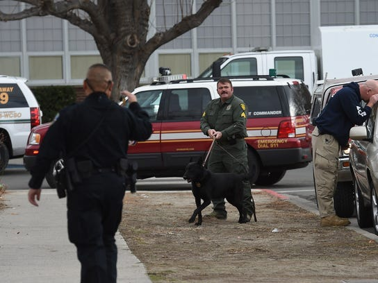 A K-9 is used to search cars parked near Sparks High