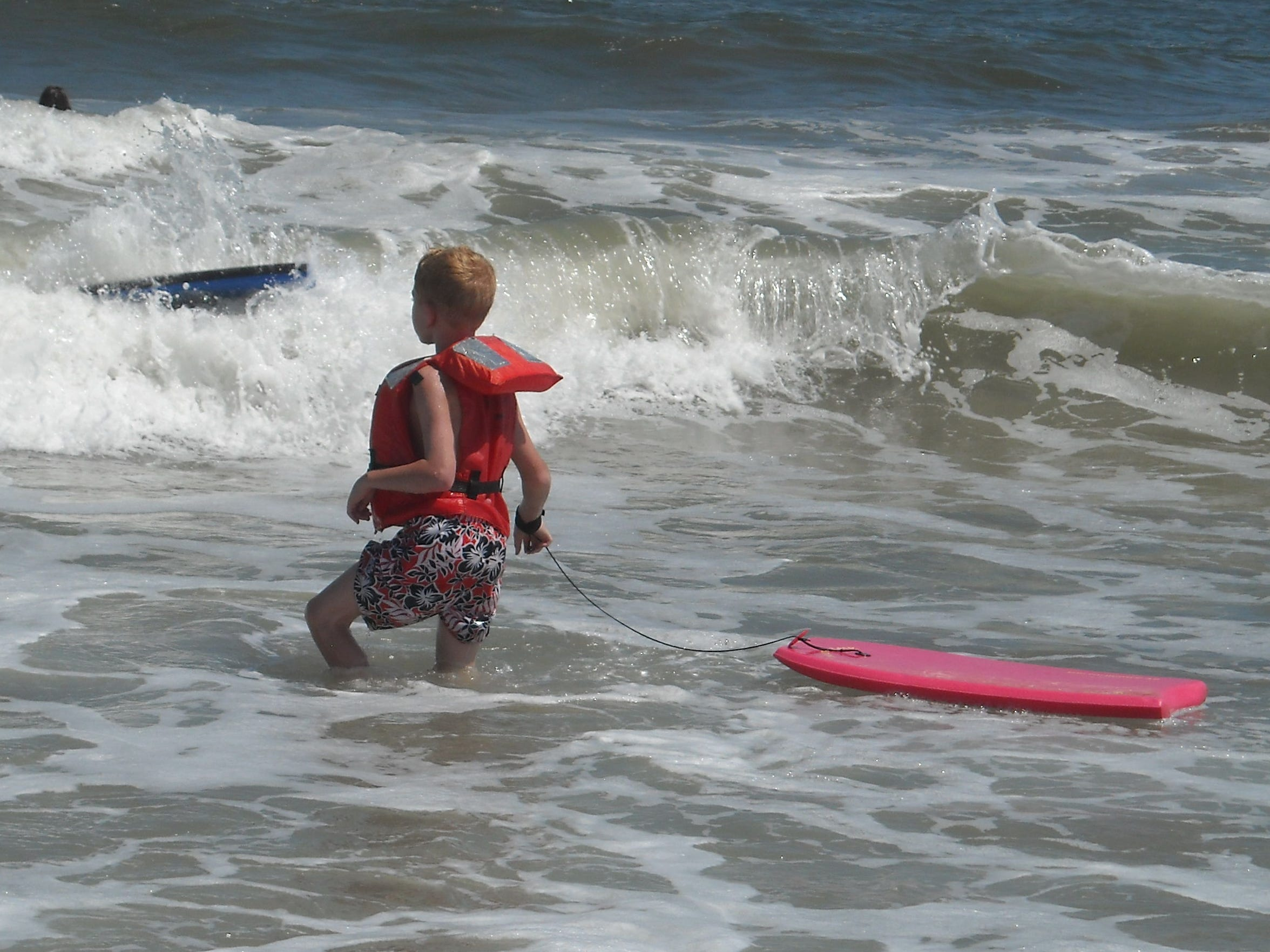 Candon Westervelt boogie boarding during a family vacation