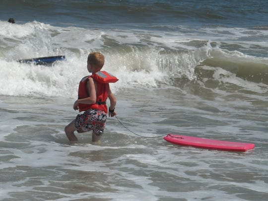 Candon Westervelt boogie boarding during a family vacation at Virginia Beach in August 2014.