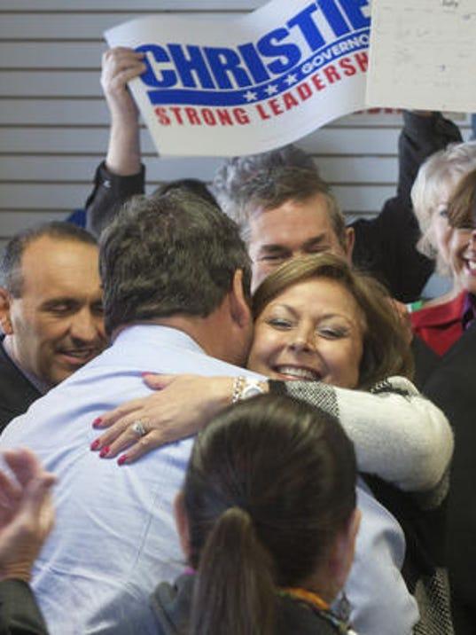 Gov. Chris Christie and New Mexico Gov. Susana Martinez hug at a campaign stop in Freehold in November 2013. (Bob Bielk/Asbury Park Press)