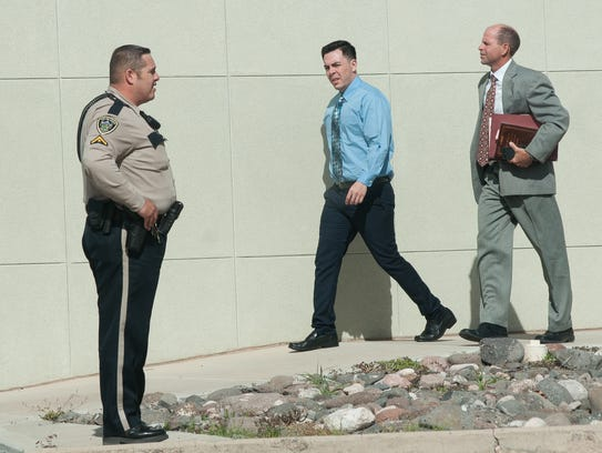 A Doña Ana County Sheriff's deputy stands by as Christopher