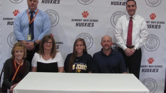 Jessica Hrnciar will be a member of the track and field team next year at The College of New Jersey. Standing are Principal Jim Wichmann, far left; and Athletic Director Michael Oppido. Sitting, from left: guidance counselor Patty Marchese, Hrnciar's mother, Joanne; Jessica Hrnciar; and her father, Joseph.