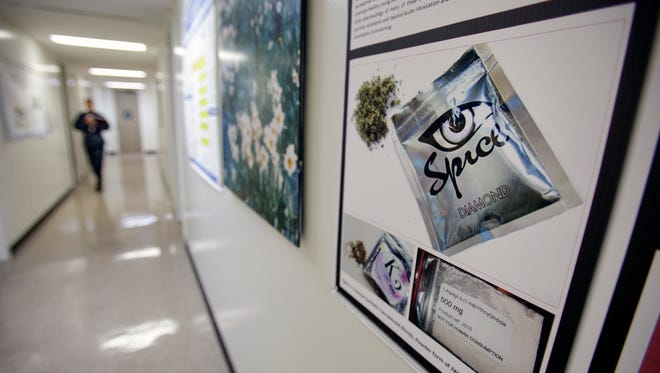 In this photo taken Tuesday, Dec. 6, 2011,  a poster warning of the effects of the drug known as 'spice' hangs on a wall at the Naval Hospital, in San Diego.