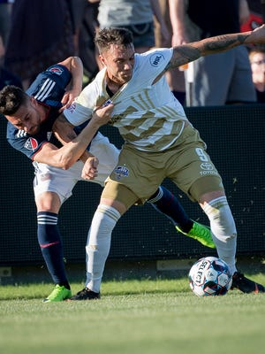 Louisville City FC forward Cameron Lancaster (9) plays against New England Revolution forward Krisztian Nemeth (9) aduring the game played at Lynn Stadium in Louisville, Ky, June 5, 2018.