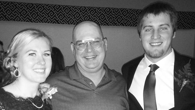 Post-Crescent engagement editor Jen Zettel, left, joins her father, John, and her brother, Robert, at a family wedding in 2016.
