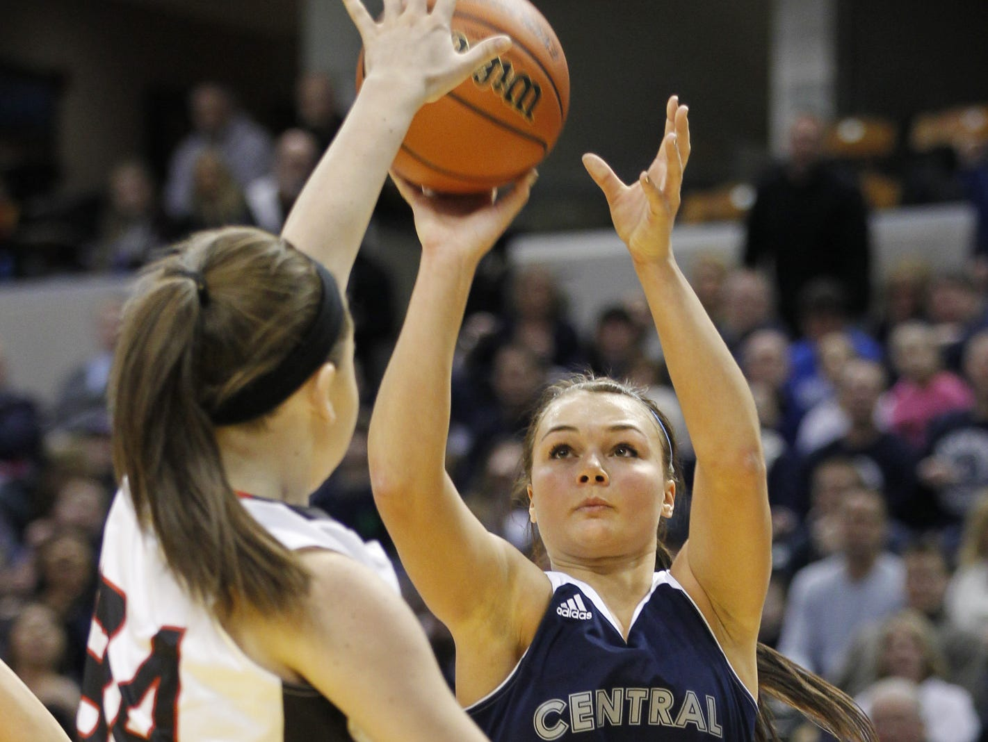 Emily Burks with a three-point shot over Meagan Knepp of Barr-Reeve in the Girls Class A Basketball State Final Saturday, March 7, 2015, at Bankers Life Fieldhouse in Indianapolis. CC defeated Barr-Reeve 52-44.