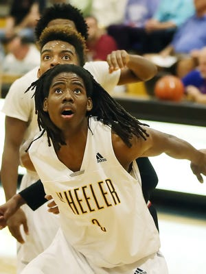Wheeler High School's Al-Wajid rebounds against Wesleyan Christian Academy during play Friday in the Culligan City of Palms Classic at Bishop Verot High School in Fort Myers. Wheeler beat Wesleyan 64-58.