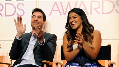 Actors Dylan McDermott, left, and Gina Rodriguez react from the stage as nominations are announced for the People's Choice Awards 2015 on Tuesday in Beverly Hills, Calif. The annual awards show will be held on Jan. 7, 2015 at the Nokia Theatre in Los Angeles.