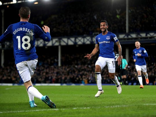 Everton's Theo Walcott celebrates scoring his side's second goal of the game during their English Premier League soccer match against Leicester City at Goodison Park, Liverpool, England, Wednesday, Jan. 31, 2018. (Nick Potts/PA via AP)