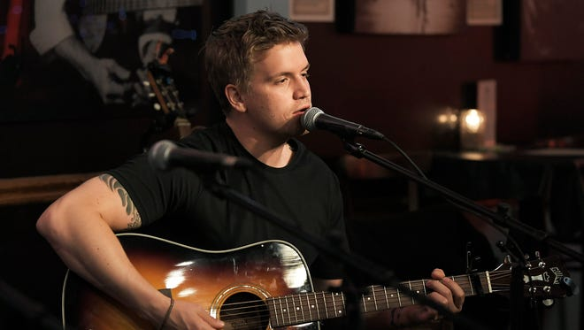 Nashville singer-songwriter Levi Hummon performs during a songwriting round event at the Bluebird Cafe on April 5, 2018.