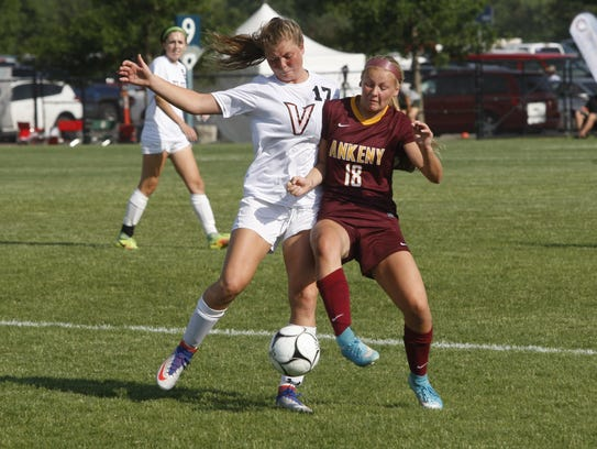 Ankeny's Jaelynn Kueker battles for the ball with Valley's