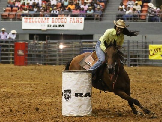 Aleah Jones, of Tyler, Texas, competes in barrel racing at the the annual Bayou Black Rodeo at the Monroe Civic Center on Saturday, August 20, 2016.