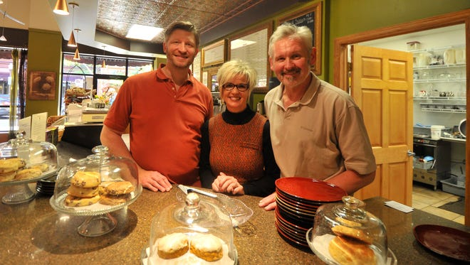 From left: Ken Lassa, Becky Hummer and Jim Wanta stand behind the counter at Allister  Deacon's Coffee House. Hummer is the new owner of the coffee shop, which was started by Wanta and Lassa nine years ago.