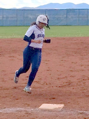 Silver's Daezia Morales trots around third base after her solo blast in the fifth inning Tuesday against Cobre High.