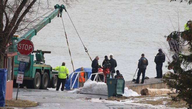 SUV being pulled from river.
