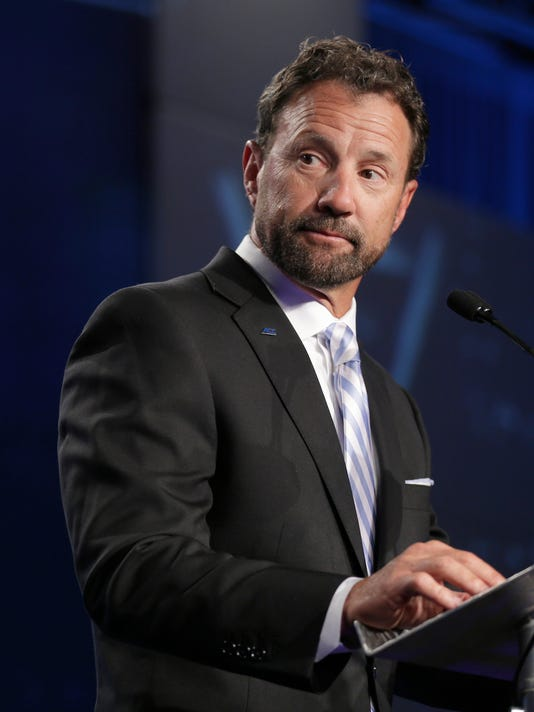 North Carolina head coach Larry Fedora speaks to the media during the Atlantic Coast Conference NCAA college football media day in Charlotte, N.C., Friday, July 14, 2017. (AP Photo/Chuck Burton)