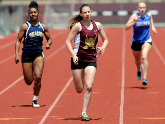 Beacon High School's Victoria Telesco, left, and Arlington's Molly Sobolewski, center, among others, compete in the second heat of the 400-meter dash on Saturday in Freedom Plains.