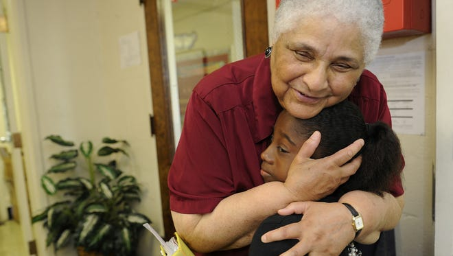 The Tennessean file photo of Sister Sandra Smithson hugging sixth-grader Moriah Coffee in 2011. Smithson founded Smithson Craighead Academy.