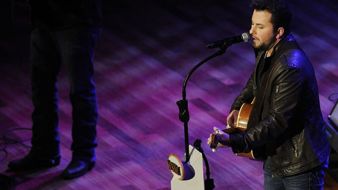 Tyler Farr performs at the Opry at the Ryman Saturday, Nov. 17, 2012 in Nashville.
