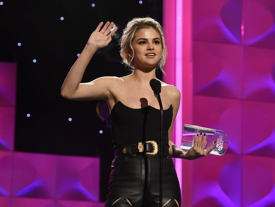 Selena Gomez Accepts the Woman of the Year Award onstage