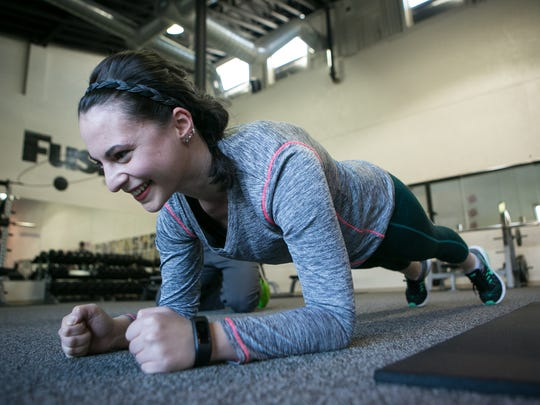 Jen Rini does planks which helps develop strength in the core, shoulders, arms, and glutes. Steve Sinko with Fusion Fitness Center in Newark shows reporter Jen Rini different exercises to do at home in the cold.