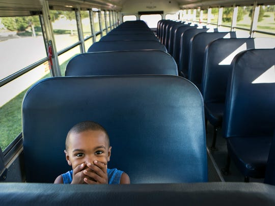 Trevor Green, 6, shows his excitement as he tries out one of the seats on the school bus after meeting his bus driver, Keith Shoemaker, better known as Mr. Shoe, during a practice run of the Appoquinimink School District's bus routes last week.