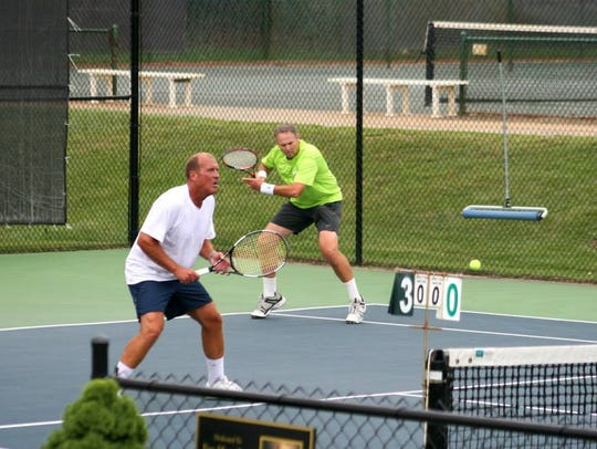 Laneal Vaughn and Jeff Duncan play doubles on the Asheville