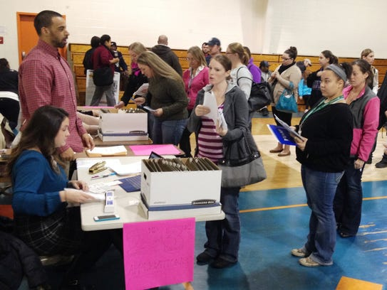 Parents line up to apply to enroll their children at