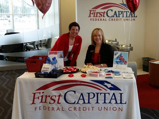"From left: Jenna Reachard, assistant branch manager and Sue DeStephano, president/CEO prepare for members during four ""Meet Sue"" lobby days hosted by First Capital FCU."