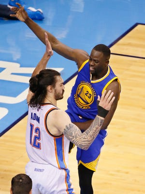 Golden State Warriors Draymond Green (23) fouls Oklahoma City Thunder center Steven Adams (12)  in the first half in Game 3. The Thunder aren't sure whether Green intentionally targeted Adams' groin area on Sunday night.
