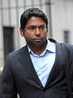 File photo shows Rengan Rajaratnam leaving Manhattan federal court in New York City after a 2013 hearing.