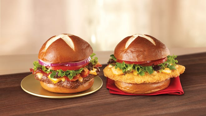 6/2014 _ The Pretzel Bacon Cheeseburger and Pretzel Pub Chicken Sandwich are both returning to restaurants by the weekend of July 4, and will be available to have, to hold and to cherish all summer long for a recommended price of $4.99 and $5.09, respectively.  Handout from Wendy's  Pretzel burger [Via MerlinFTP Drop]