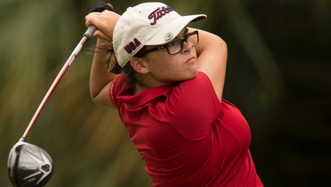 Port St. Lucie's Zoe Iglesias watches her tee shot on the first hole during the high school girls golf match between Port St. Lucie, Treasure Coast and John Carroll Catholic at St. Lucie Trail Golf Club on Monday, Aug. 28, 2017, in Port St. Lucie.