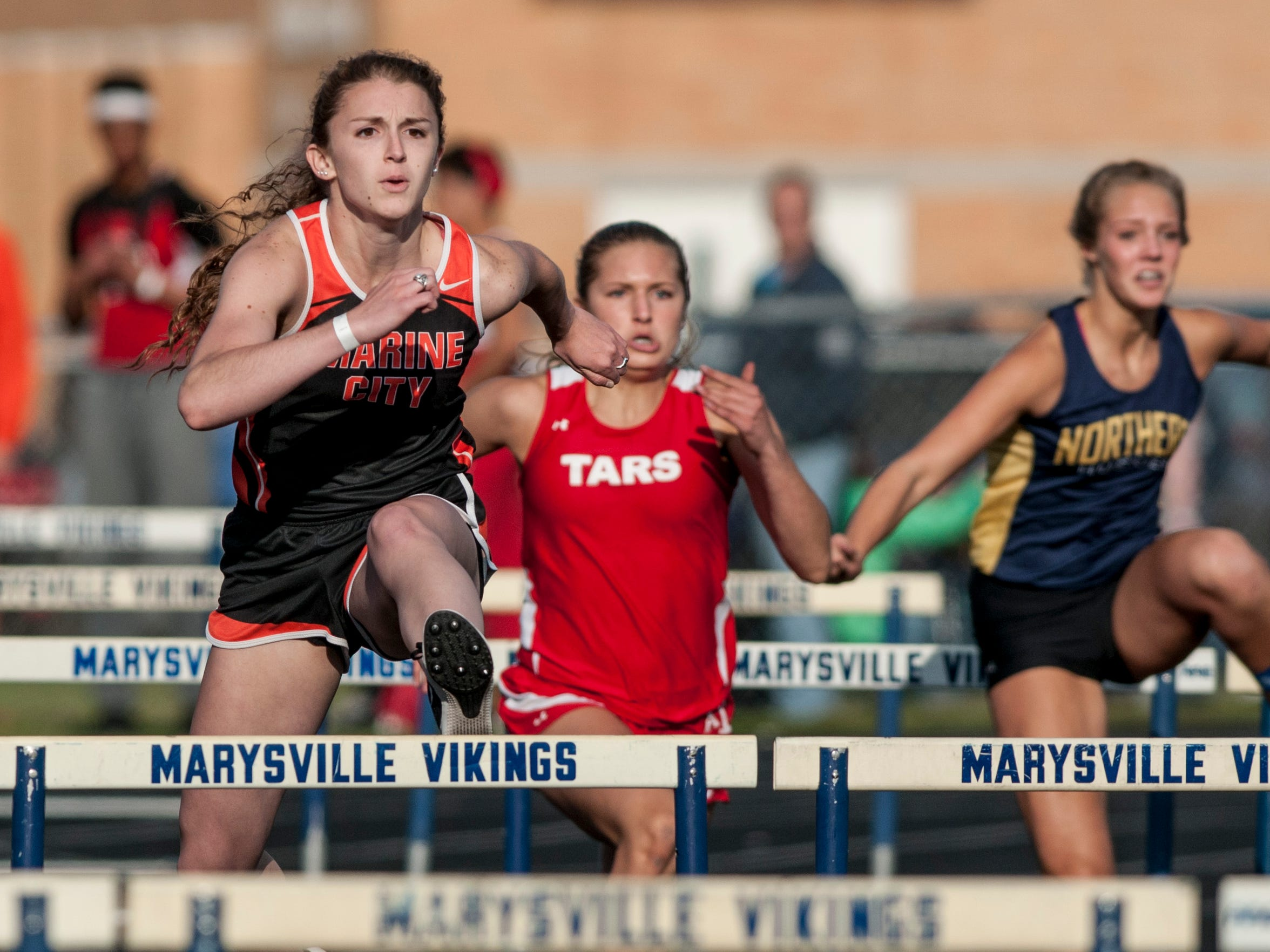 Marine City senior Hannah Coverdill competes in the 100-meter hurdles during the Marysville Invitational track meet Friday, May 13, 2016 at Marysville High School.