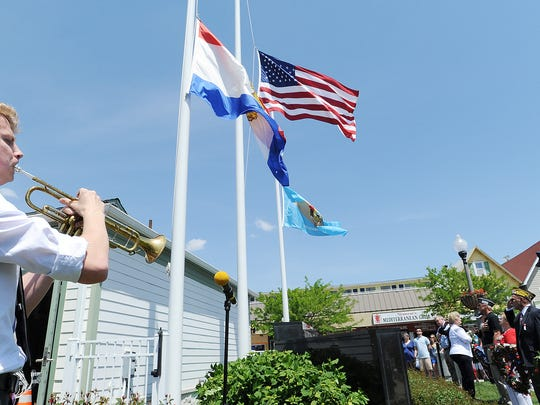 Taps is played by Cape Henlopen Trumpeter Evan Mallon as Memorial Day services are held in Rehoboth Beach, sponsored by VFW Post 7447. Great weather brought out a crowd to pay tribute to those who died while serving in the country's armed forces.