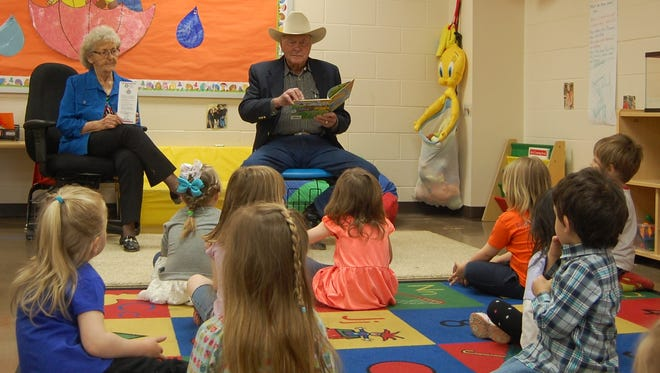 """Forrest and Nina Wood read """"The Little Engine That Could"""" to children at the preschool in Flippin."""