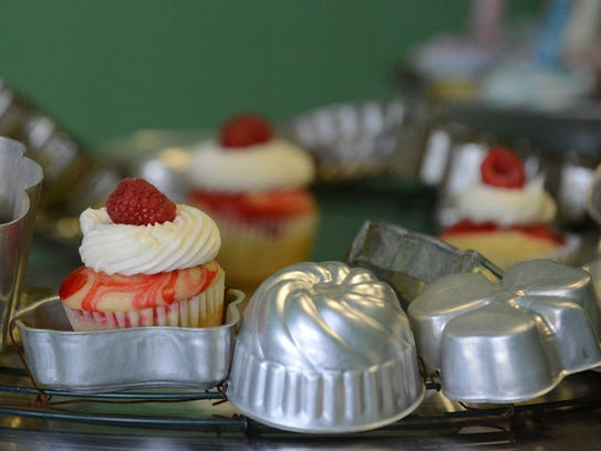 Cupcakes from The Confectionary sit on a display at