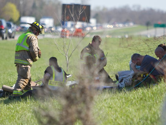 Emergency personnel rest on the scene of a double-fatal