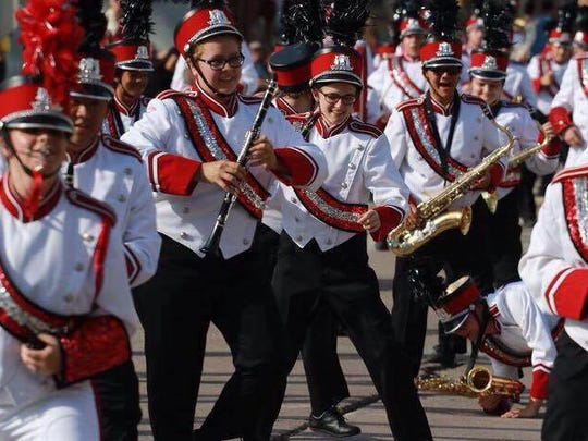 Paige Bootz, background, far right, marches with the Wausau East High School band. Bootz died in a car crash Monday.