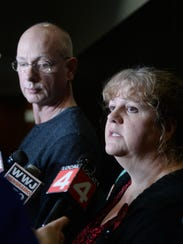 Ann and Richard Stislicki talk to reporters outside